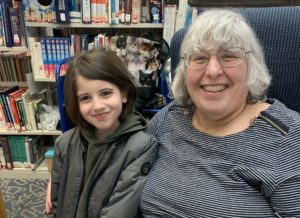 Children's librarian, Faye Lieberman and one of the boys who frequents her library