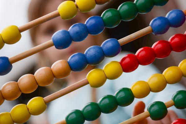 girl looking at math beads